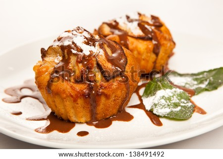 cake drizzled with chocolate, decorated with mint - stock photo