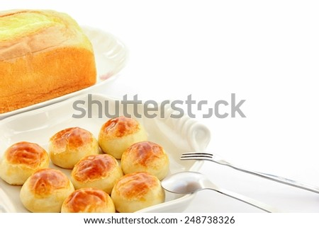 Cake, fork and spoon on white background. - stock photo