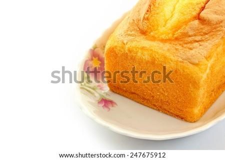 Cake in dish on white background. - stock photo