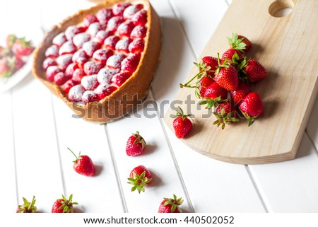 cake in the form heart on wood table - stock photo
