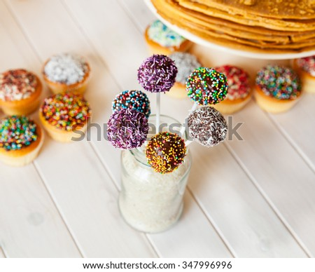 cake pops on the holiday table. sweetness. candies on wooden background - stock photo