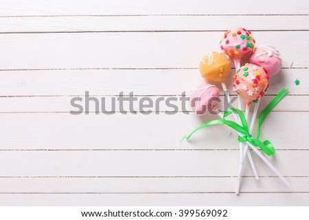 Cake pops on white wooden background. Selective focus.Place for text. - stock photo
