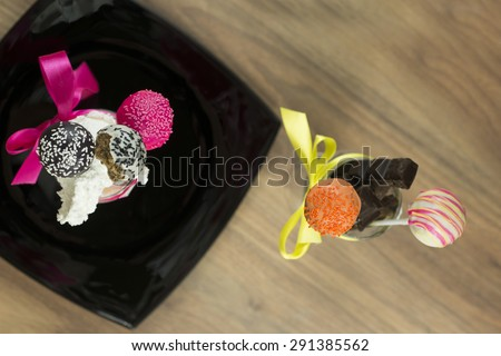 Cake pops, sweet soft food made from a mixture of flour, shortening, eggs, sugar, and other ingredients, baked and often decorated - stock photo