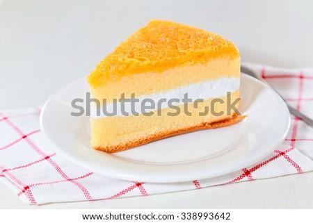 Cake slice in white dish. - stock photo