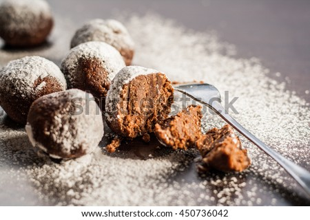 cake truffle potatoes sprinkled with powdered sugar.