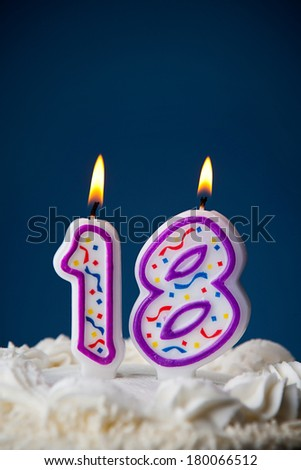 Cake: White Iced Birthday Cake With Candles For 18th Birthday - stock photo