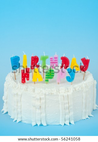 Cake with Birthday Candles on Blue Background - stock photo