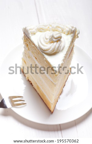cake with buttercream on white table, shallow dof - stock photo