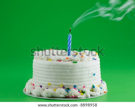 Cake with candle blown out - stock photo