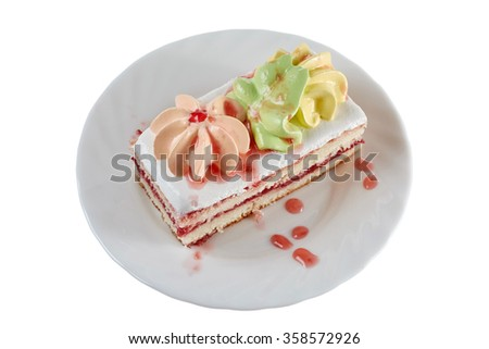 cake with drops of strawberry jam on a plate on a white background - stock photo
