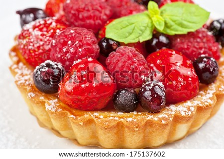 Cake with fresh berries and mint closeup - stock photo
