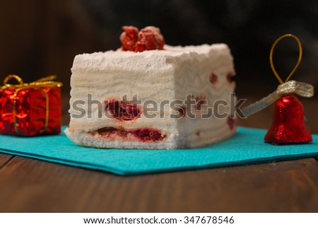 cake with fresh cherry on wooden background