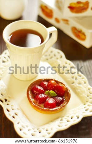 Cake with fresh strawberries and tea - stock photo