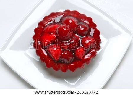 cake with fresh strawberry jelly on white background - stock photo