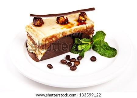 Cake with hazelnut, honey and mint on white background - stock photo