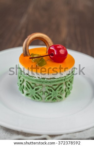 Cake with jelly and cherry - stock photo