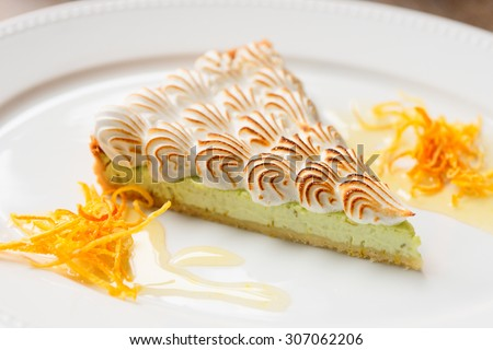 Cake with meringue on plate - stock photo