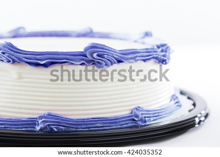 Cake with plain frosting and space for text on a bright background - stock photo