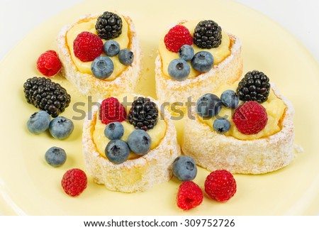 Cake with powdered sugar and strawberry, isolated on a white background - stock photo