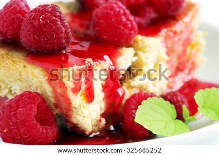 cake with raspberries and cream cheese decorated with fresh raspberries and mint. the toning. selective focus - stock photo