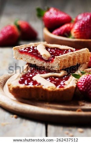 Cake with strawberry on the wooden table, selective focus - stock photo