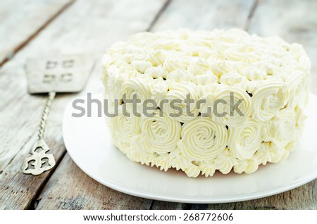 cake with vanilla cream in the form of roses on a white background. tinting. selective focus - stock photo