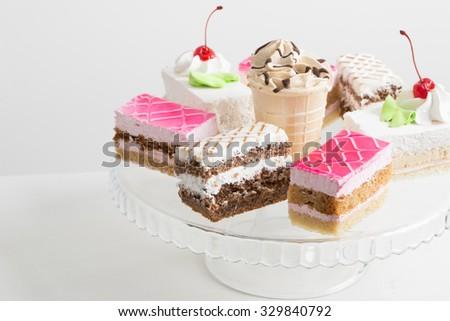 cakes on white table - stock photo