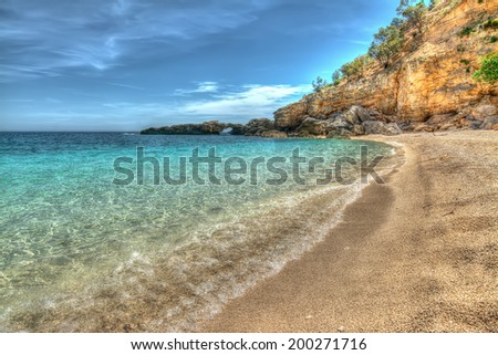 Cala Biriola on a clear day in hdr - stock photo