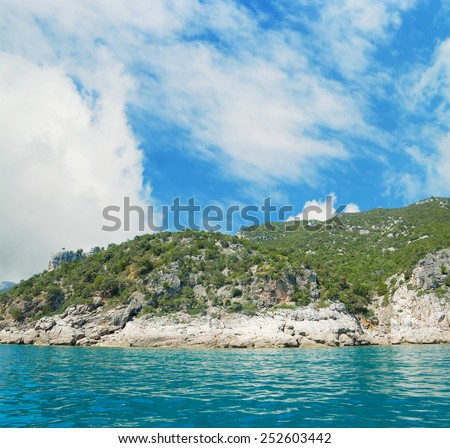 Cala Gonone coastline seen from the sea. Shot in Sardinia, Italy - stock photo