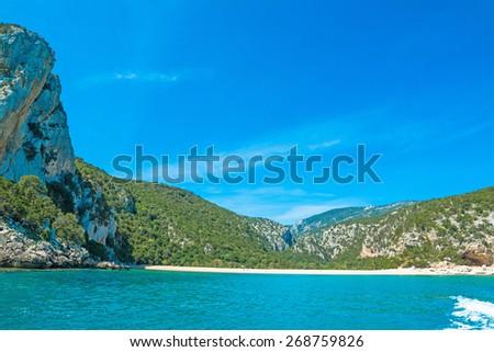 Cala Gonone shoreline on a clear day, Sardinia - stock photo