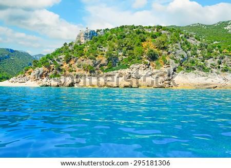 cala gonone shoreline on a cloudy day, Sardinia - stock photo