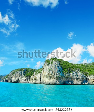 Cala Gonone shoreline on a cloudy day. Shot in Sardinia, Italy - stock photo