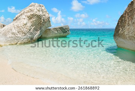 Cala Mariolu rocks under a clear sky in the summer - stock photo