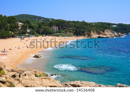 Cala Rovira beach in Platja d'Aro, a well known tourist destination (Costa Brava, Catalonia, Spain) - stock photo