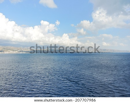 Calabria, Italy coastline from Strait of Messina in summer day - stock photo