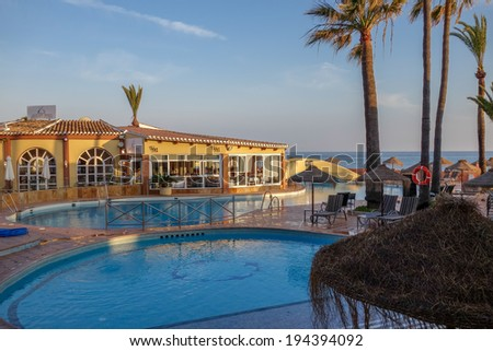CALAHONDA, ANDALUCIA/SPAIN - MAY 8 : Evening sunshine at Dona Lola holiday resort in Calahonda Spain on May 8, 2014. Unidentified people.