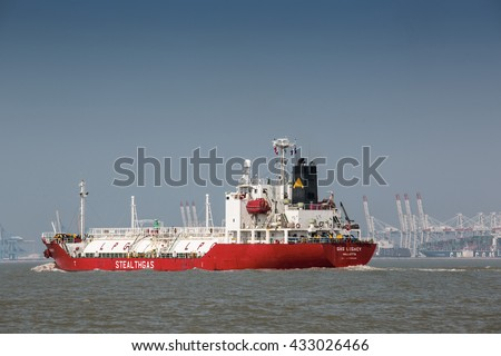 CALAIS, FRANCE - APRIL 8, 2015: LPG Gas Transport Ship leaving Calais, heading towards the English Channel - stock photo
