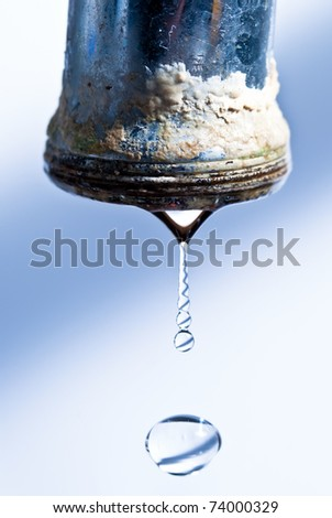 calcified dripping faucet isolated - stock photo