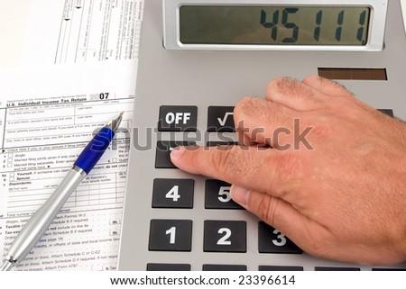 calculating tax - stock photo