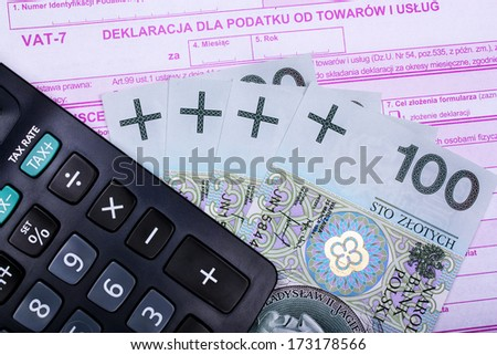 Calculating taxes in poland  currency  - stock photo