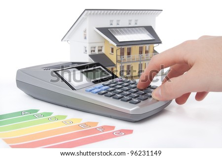 Calculation for energy positive (active) house concept. - stock photo