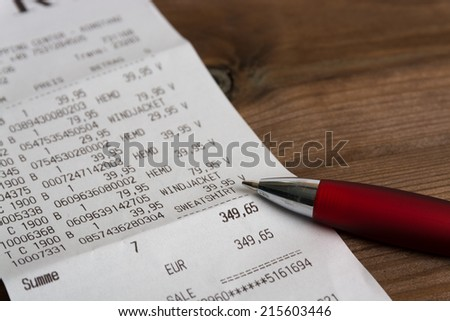 calculation with pen on table - stock photo