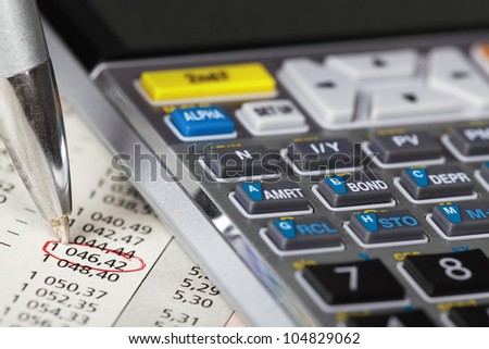 Calculator and a financial document. Accountant. - stock photo