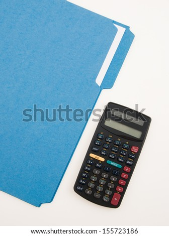 Calculator and blue folder for budget notes - stock photo