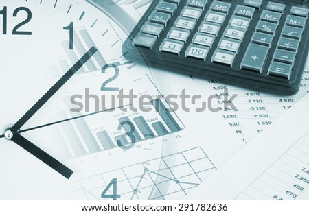 Calculator and clock on financial documents