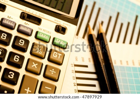 Calculator and diagram - stock photo
