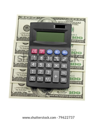 Calculator and dollars isolated on a white background - stock photo