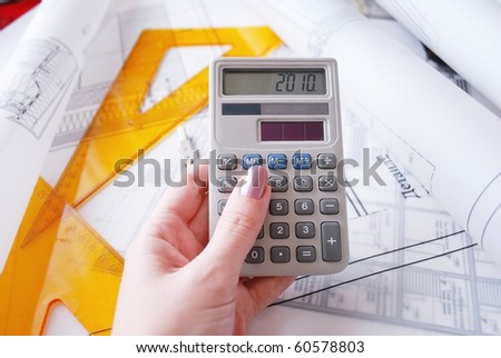 Calculator and drafting tools ot architectural desk - stock photo