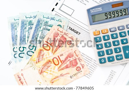 Calculator and Money for check budget - stock photo