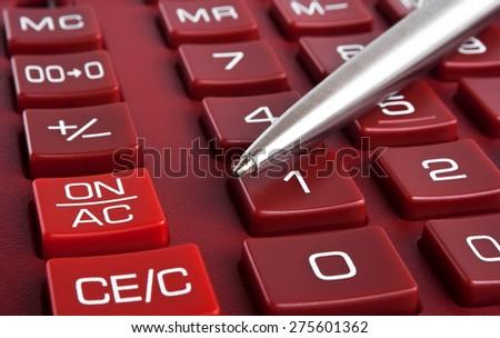 Calculator and pen, close up - stock photo